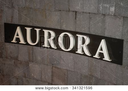 Bento Goncalves, Brazil - July 11, 2019. Company Signboard On A Stone Wall With The Name Of Aurora W