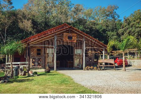 Bento Goncalves, Brazil - July 11, 2019. Wooden Facade Of Rustic Restaurant And Trees In A Farm Near