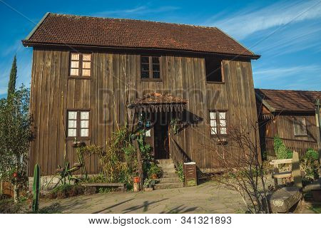 Bento Goncalves, Brazil - July 11, 2019. Facade With Entrance Of Charming Wooden Old House In A Trad