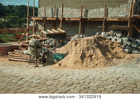 Bento Goncalves, Brazil - July 13, 2019. Cement Mixer With Wooden Scaffolding And Sand Pile At The D