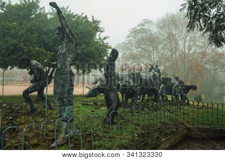 Bento Goncalves, Brazil - July 14, 2019. Bronze Statues Of People And Ox Cart At The Immigrant Monum