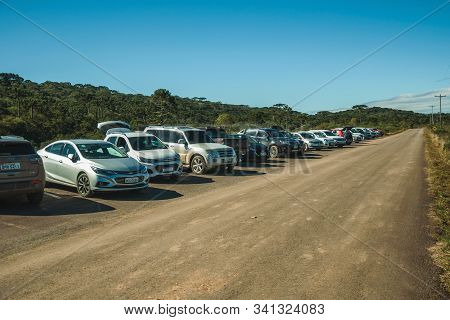 Cambara Do Sul, Brazil - July 16, 2019. Cars Parked By The Side Of A Paved Road At Aparados Da Serra
