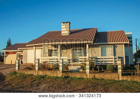 Cambara Do Sul, Brazil - July 16, 2019. Charming Modern Townhouse With Fence And Garden At Sunset, I
