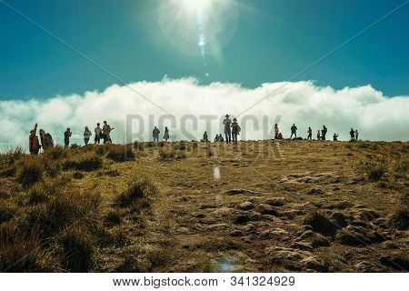 Cambara Do Sul, Brazil - July 18, 2019. People On Summit Of Cliff At Fortaleza Canyon With Sunlight