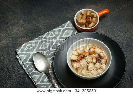 Hearty Lunch. Meat Broth Or Bouillon  From Veal With Breadcrumbs On A Dark Background.