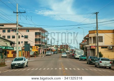 Cambara Do Sul, Brazil - July 19, 2019. Townhouses, Stores And Light Poles In The Getulio Vargas Ave
