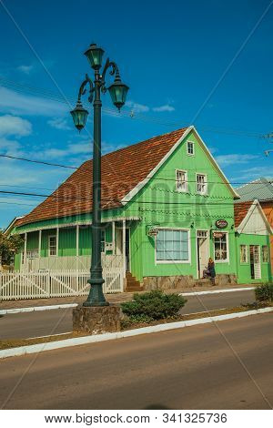 Cambara Do Sul, Brazil - July 19, 2019. Wooden Old Houses And Store In The Calm Getulio Vargas Avenu
