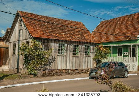 Cambara Do Sul, Brazil - July 19, 2019. Wooden Old Houses In The Calm Getulio Vargas Avenue, The Mai
