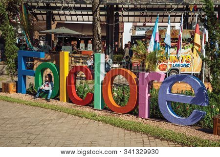 Nova Petropolis, Brazil - July 20, 2019. Colorful Sign With The Word Folklore And A Child At The 47t