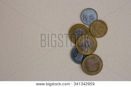 Indian Coins With Focus On 10 Rupee Coin On White Background. 10, 5 Indian Coinage Use For Financial