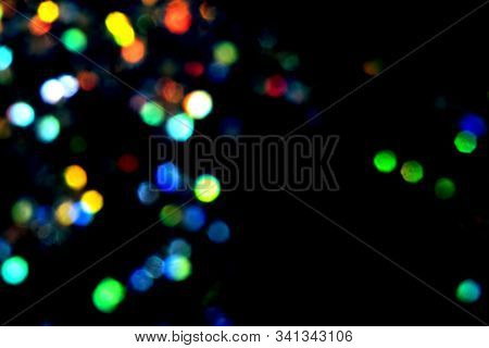 Beautiful And Festive Multicoloured Blurred Lights On Black Background.