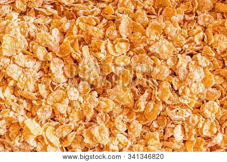 Frosted Corn Flakes Closeup Background. A Sugary Breakfast Favorite.