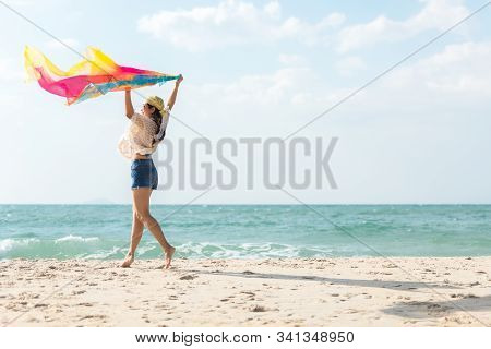 Summer Vacation.  Traveler Women Relaxing And Joy Fun On The Beach, So Happy And Luxury And Destinat