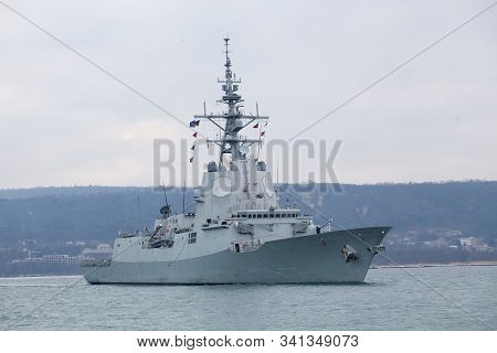 Grey Military Ship, Arriving In The Port.