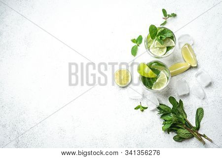 Refreshing Mojito Cocktail  With Mint, Rum And Lime, Cold Drink Or Beverage With Ice On White Backgr