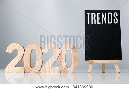 2020 Trend On Blackboard On Grey Background,business Global Trends Concept