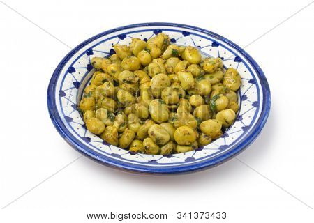 Traditional Moroccan dish with broad bean salad and herbs isolated on white background