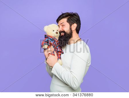 Bearded Man Hugs Teddy Bear Plush Toy. Gift And Present. Holiday. Celebration. Smiling Man Hugs Tedd