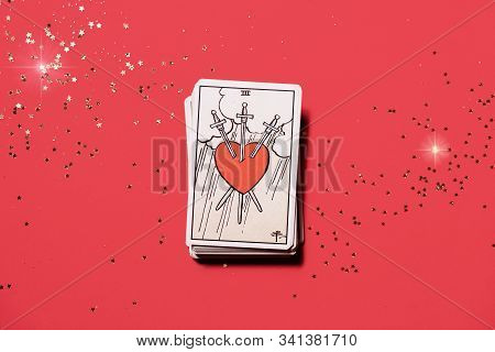 Tirana, Albania. December 2019: Deck Of Tarot Cards On A Table With Main Card Of Three Of Swords, Lo