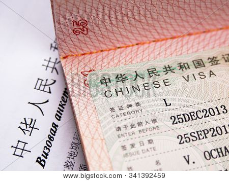 Chinese Visa In An International Passport. Translation Text:
