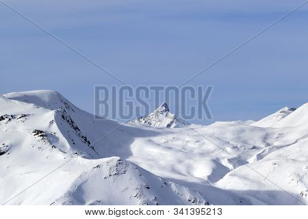 Snowy Off Piste Ski Slope, Sunlit Plateau And Peak At High Winter Mountains. Italian Alps. Livigno,