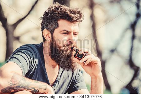 Health Safety And Addiction. Inhaling Vapor. Bearded Brutal Male Smoking Electronic Cigarette. Hipst