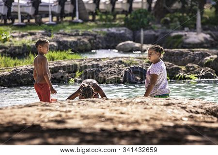 Poor Dominican Children Play In Bayahibe 3
