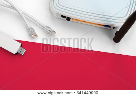 Poland Flag Depicted On Table With Internet Rj45 Cable, Wireless Usb Wifi Adapter And Router. Intern