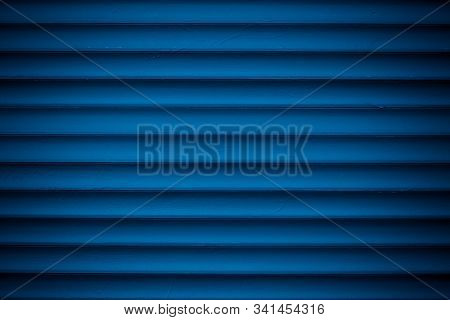 Dark Blue Metallic Striped Surface. Metal Wall Siding. Striated Fence With Shine. Convex Wall Textur