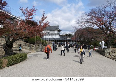 Himeji, Japan- 30 Nov, 2019: Tourist Are Walking To Himeji Castle Through The Front Garden. Himeji C