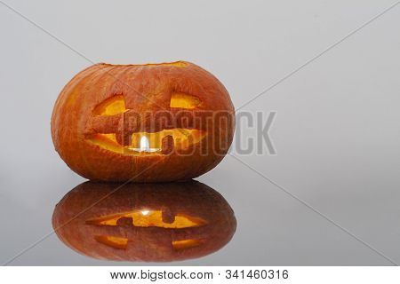 Halloween Pumpkin Jack O Latern On Dark Background.
