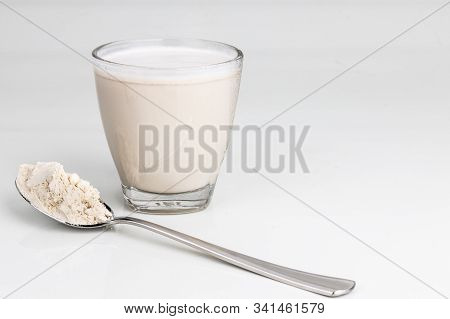 Vanilla Flavored Protein Drinks In Glass With Protein Powder Scope