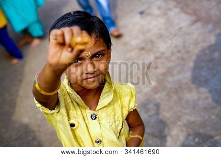 Verul Maharashtra / India - 08-12-2019 Indian Little Girl Child Trying Tilak On Good Occasions In In