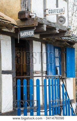 Old Barber Shop And Hairdresser Entrance In A Historic Half-timbered Alsatian House In The Black For
