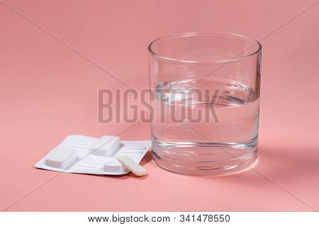 White Vaginal Antibacterial Pills On Pink Background.candles Are Soaked In Water And Injected Into V