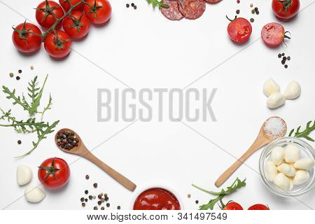 Composition With Fresh Ingredients And Space For Text On White Background, Top View. Pepperoni Pizza