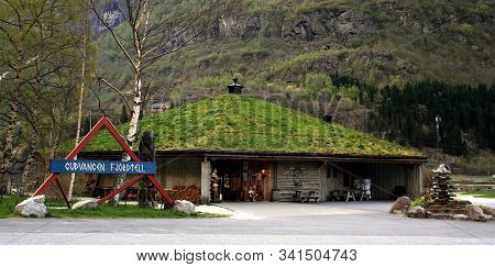 Gudvangen, Norway - May 04 2007: Pointer And Souvenir Shop With Grass On The Roof