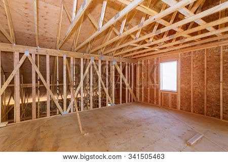 Unfinished Attic Of A Private House Residential Construction House Framing Agains