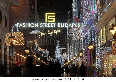 Budapest, Hungary - December 08 2019: Christmas Market & Illuminated Tree At Fashion Street. Advent