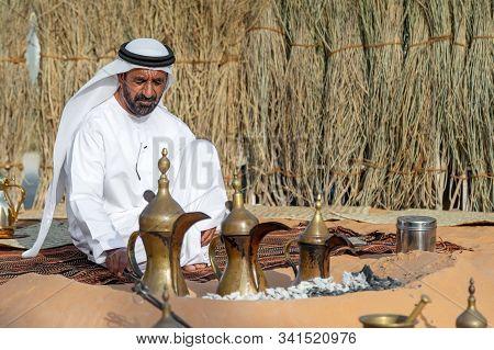 Abu Dhabi, Uae - December 14, 2019: Al Hosn Heritage Festival, Emirati Man Making Traditional Coffee