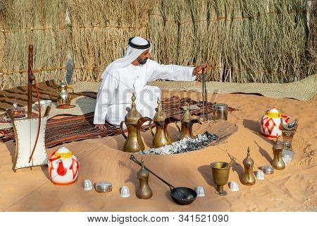 Abu Dhabi, Uae - December 14, 2019: Al Hosn Heritage Festival, Emirati Man Making Traditional Coffee