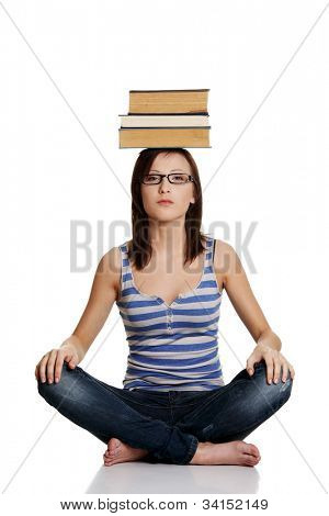 Girl with black glasses and books on her head. Isolated on the white background.