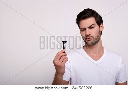 Spanish Man Looking Razor Against The Background. The Gorgeous Man Is Full Of Strength And Beauty, L