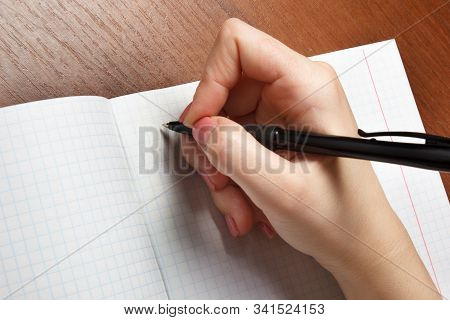 Female Hands With Pen Writing On Notebook Close Up Pov