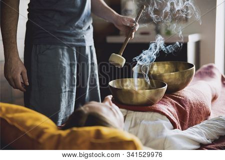 Tibetan Singing Bowls With Smoke In Sound Therapy In Spa Center