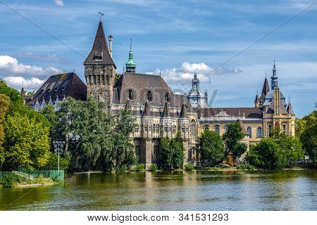 Budapest Vajdahunyad Castle Viewed From Its Lakeside With Two Pretty Young Girls In A Rowboat