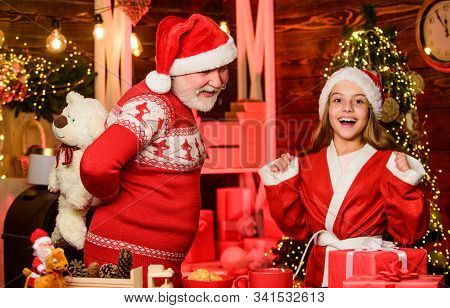 Santa Claus Generous. Child Enjoy Christmas With Bearded Grandfather Santa Claus. Festive Tradition.
