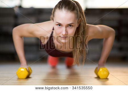 Girl Push Ups Using Dumbbell, Selective Focus