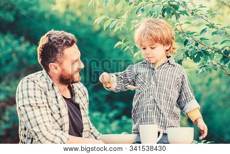Little Boy And Dad Eat. Organic Nutrition. Healthy Nutrition Concept. Nutrition Habits. Family Enjoy