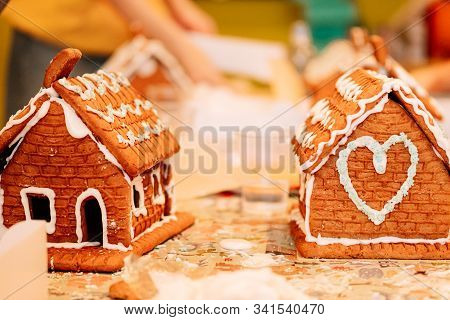 Cooking Gingerbread Cookies, A House Of Cookies For Santa, Kids Are Preparing To Eat, Decorating The